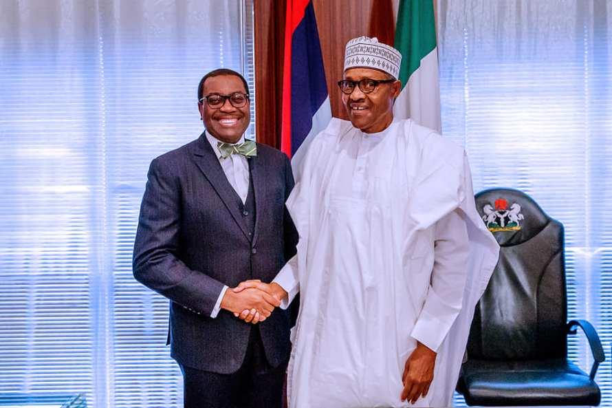 Buhari and AfDB Akinwunmi Adesina
