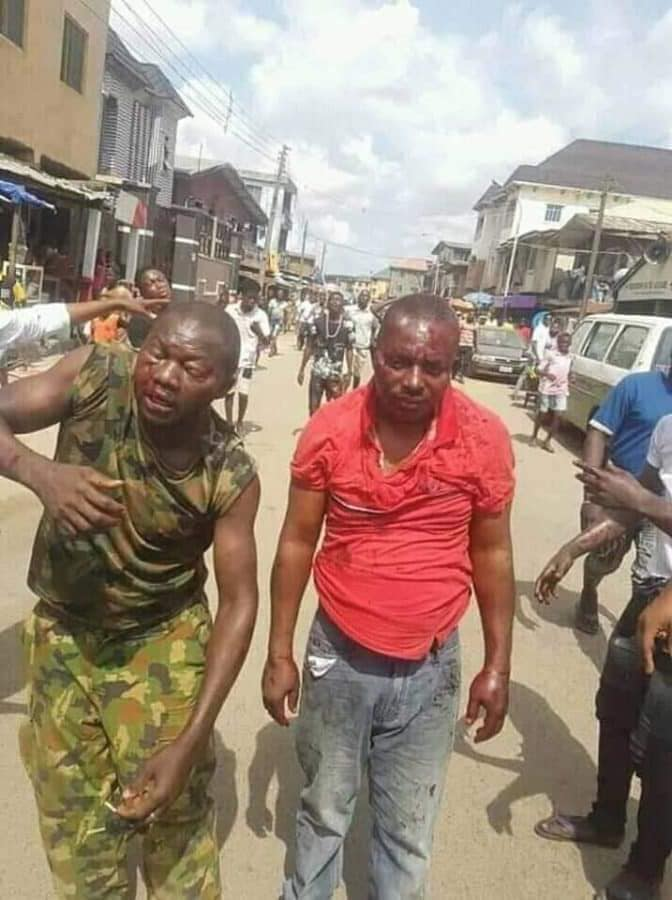 Soldiers Beaten To Pulp In Ajegunle For Preventing Jungle Justice Over Death Of 'Black Jesus'