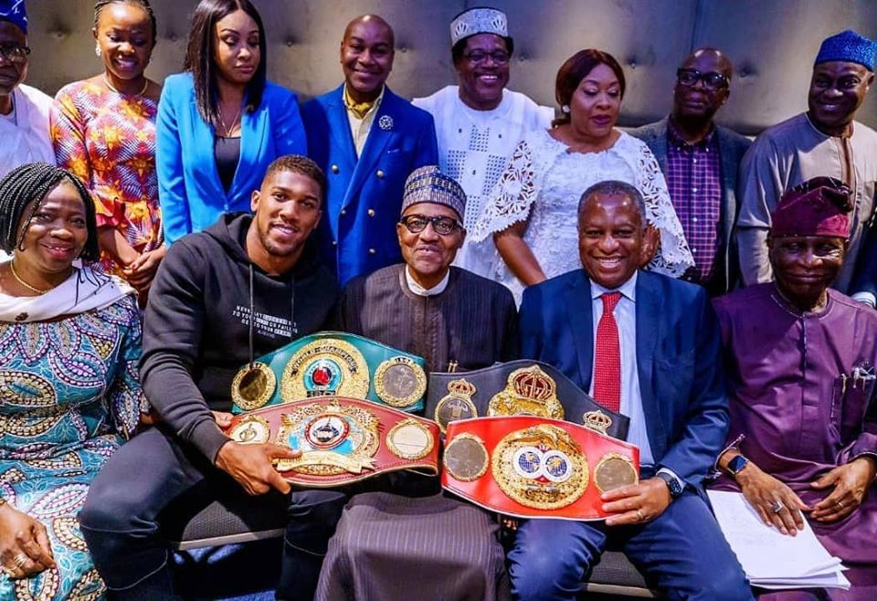 Anthony Joshua Presents Heavyweight Title Belts To PMB In London